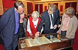 Inspecting the Beeston Bible at the Luncheon with verse 36 being pointed out by Professor John Becket. L to R: Bishop Paul Butler, Barbara Cast, Rosalys Coope, John Beckett and Dorothy Johnston	(Photo: Howard Fisher).