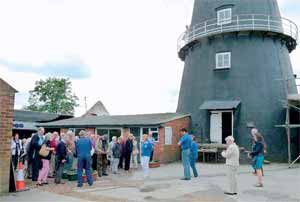 At the windmill in Heckington, with members of the party waiting to go up the mill.