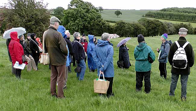 Dr. David Knight explaining features of Oxton Hill Fort to the outing group on 9 June 2012 (Photo: Howard Fisher).